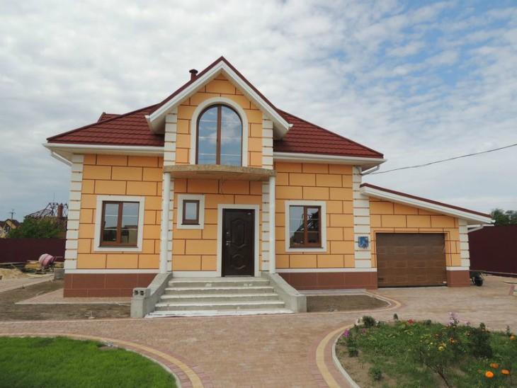 Отделка дома фасадными панелями из пенопласта
